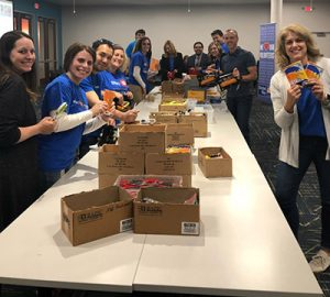 BMO volunteers packing boxes at BMO volunteer day 2019