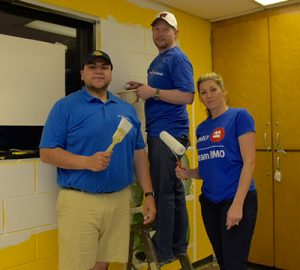 A BMO team helps with painting the space at Neighborhood House