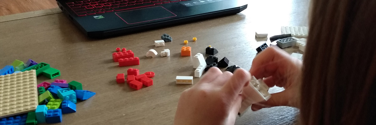 A child plays with LEGO bricks