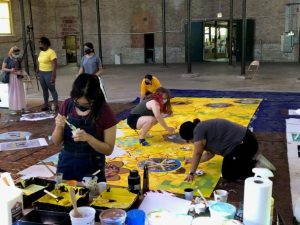Students creating a mural