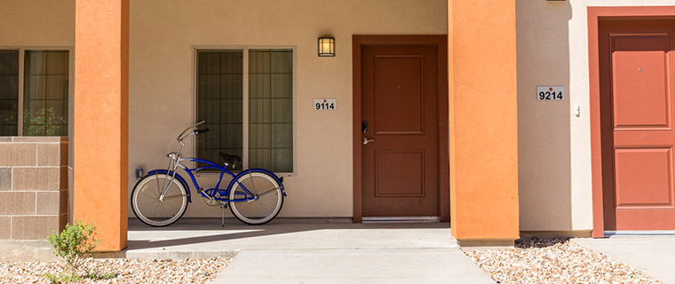 Front porch with a blue bicycle