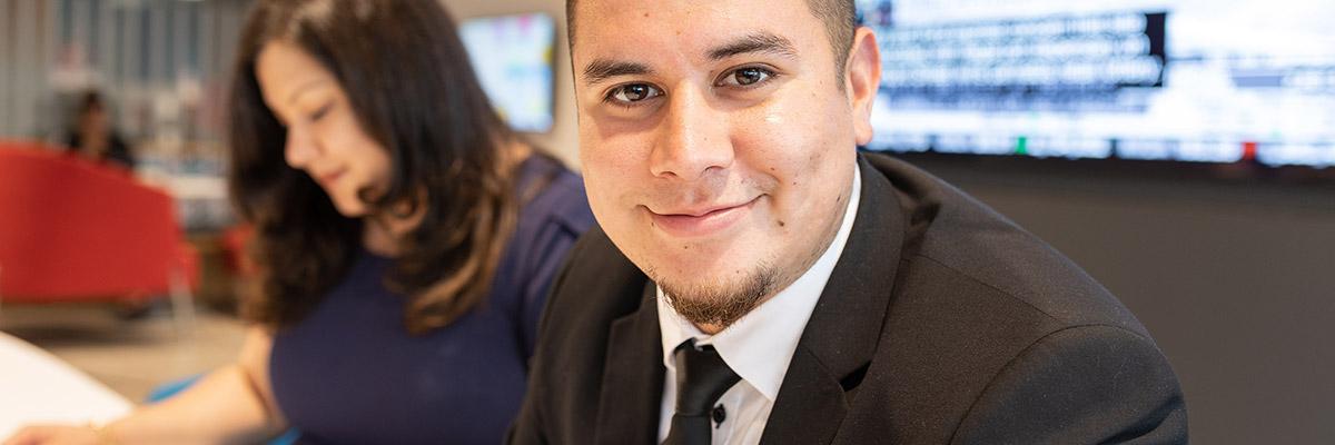 A smiling BMO employee