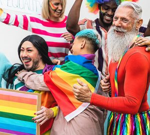 Pride revellers in colourful costumes