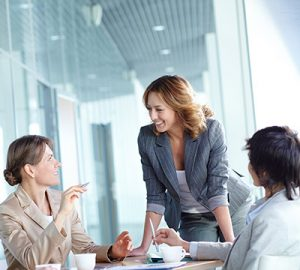Women having a discussion during a business meeting