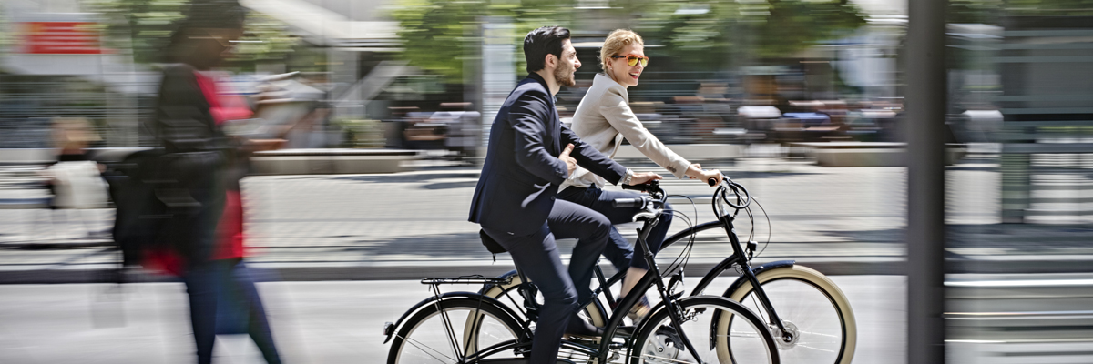 two business people riding bicycles