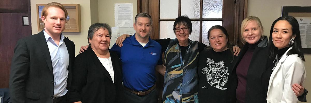 BMO's Dan Adams and Sean Murphy with Thunder Woman Healing Lodge's Board