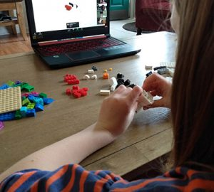 A child plays with LEGO bricks