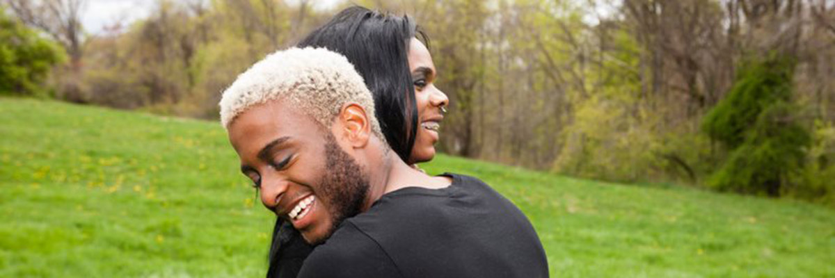 Two people hugging and smiling