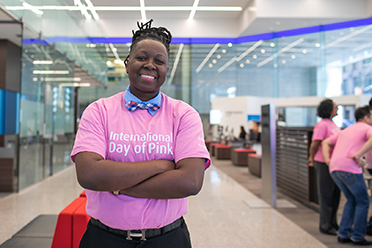 A woman wearing a pink International Day of Pink t-shirt
