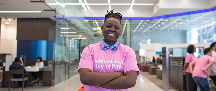 A woman wearing a pink International Day of Pink t-shirt