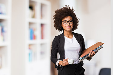 A woman of color with files in hand