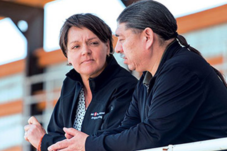A BMO banker speaking with an Indigenous client