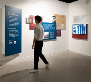 A man looking at the Chinatown Foundation display