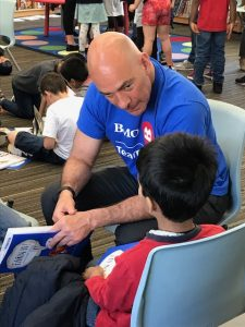 Ken Librot reads to a child at BMO Volunteer Day 2019